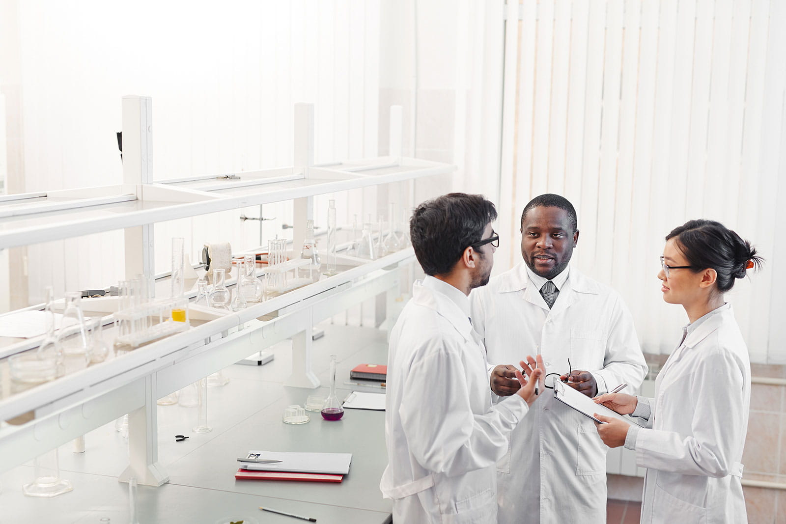 Group of researchers talking in a lab